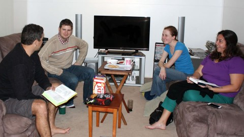 Young adults group doing a bible study.